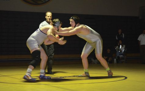Seniors wrestle final match at home