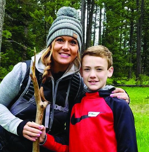 Ethan Mix smiles alongside his mom Karida Calkins.