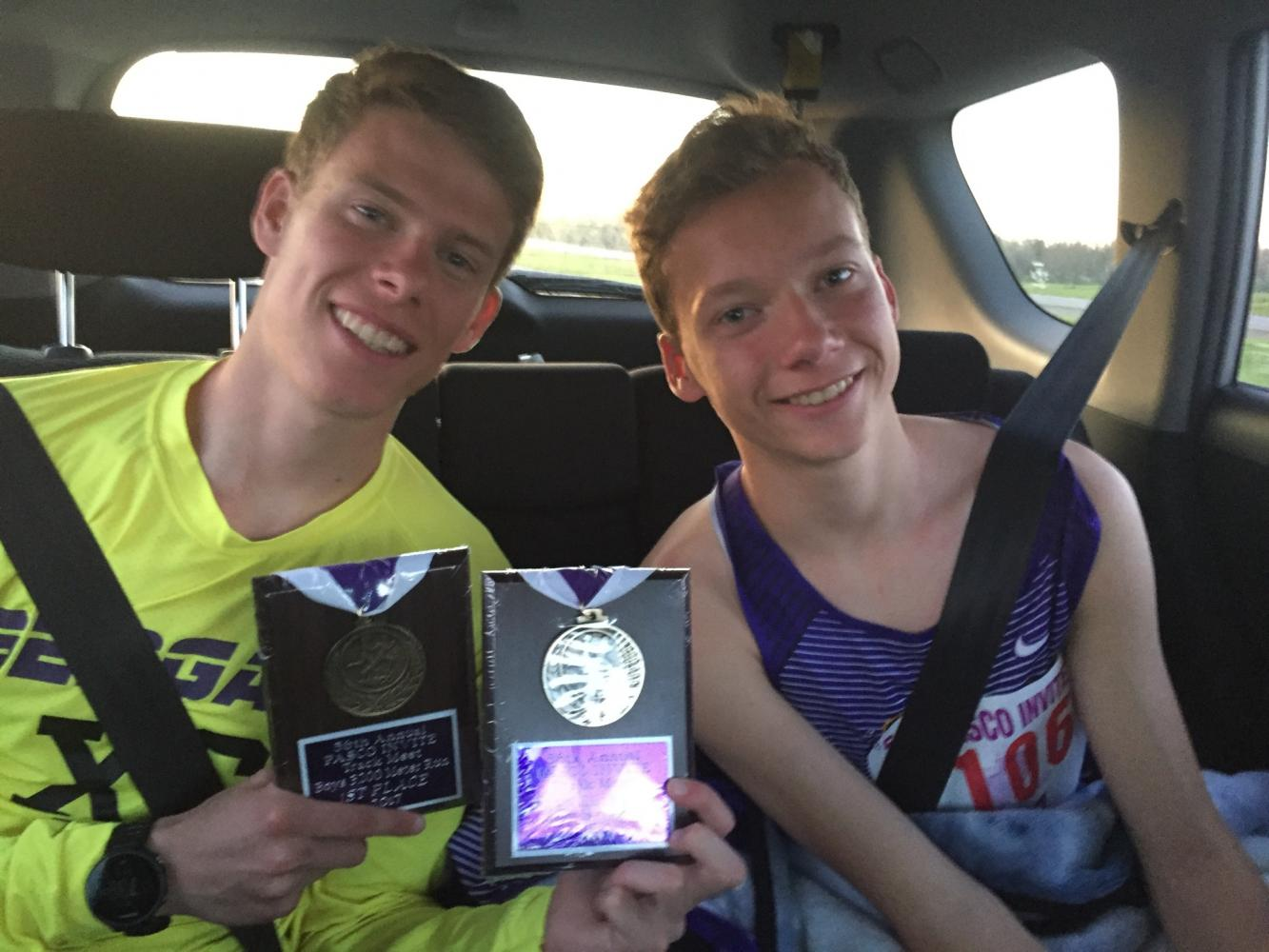 Senior Austin Byrer and freshman Caden Byrer in the aftermath of state track May 20. Austin Byrer won second in the 1,600-meter event and first place honors in the 3,200-meter event.