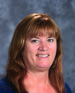 Johnson takes her photo for the yearbook for 2016-2017, her last year teaching at LHS.