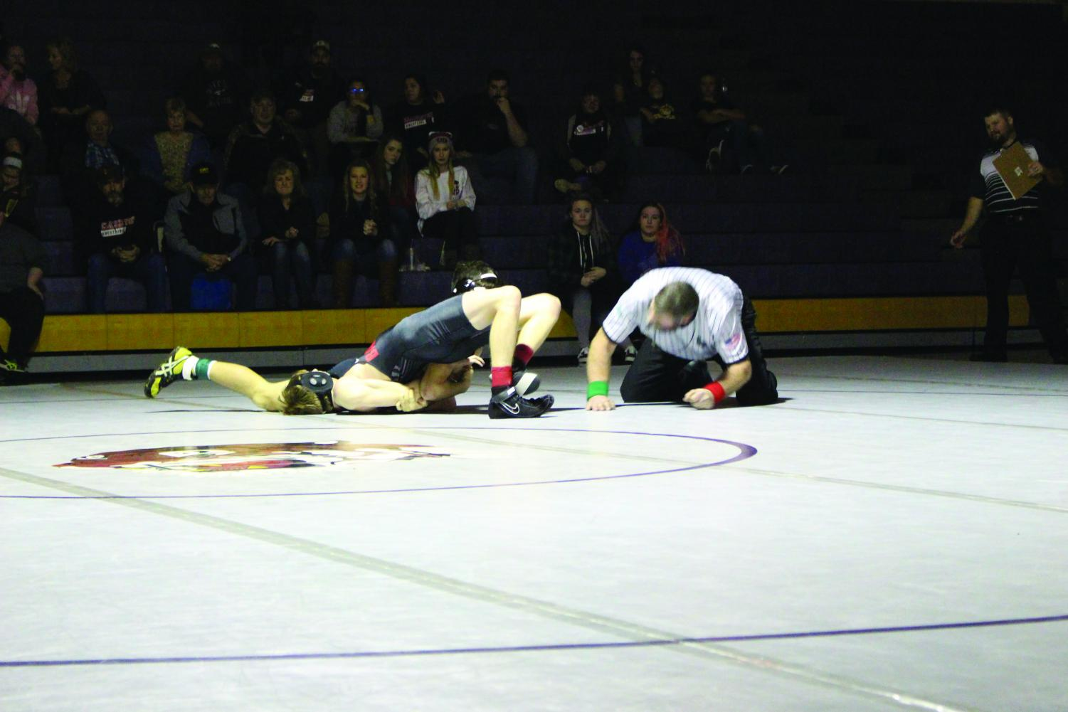 Lewiston senior, Tanner Hutchens, pins to win the match vs. Clarkston High School freshman, Jayden Musgrove, Jan. 16 at Booth Hall..