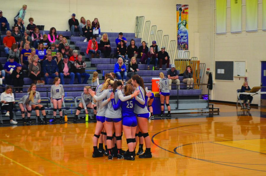 The varsity volleyball huddles, giving everyone luck on their match against Coeur d'Alene High School, Oct. 17.
