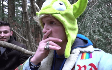 Logan Paul deep in thought as he records body of suicide victim. photo courtesy of nymag.com