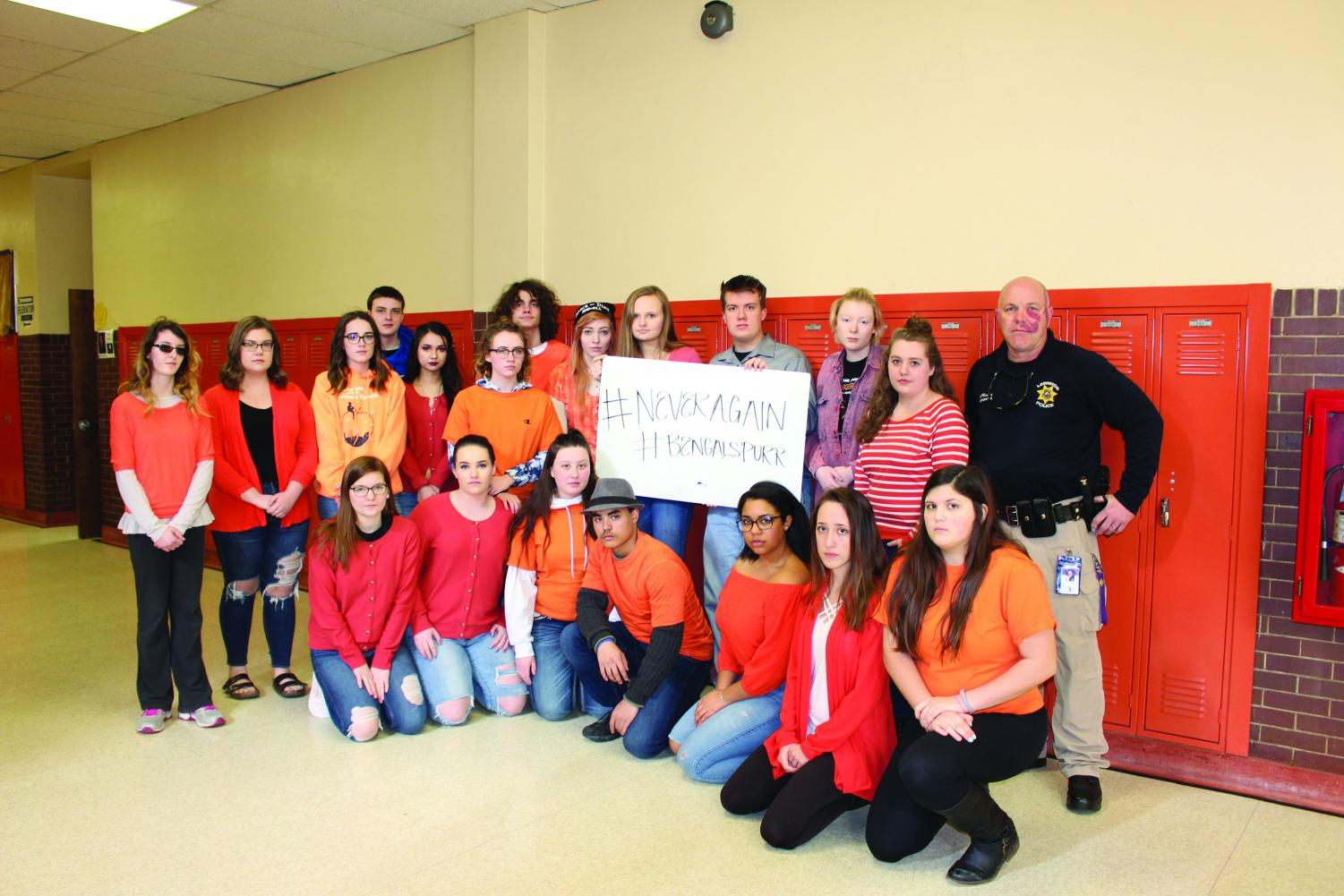The current staff of The Bengal's Purr at Lewiston High School, with LHS student resource officer, Robert Massey.