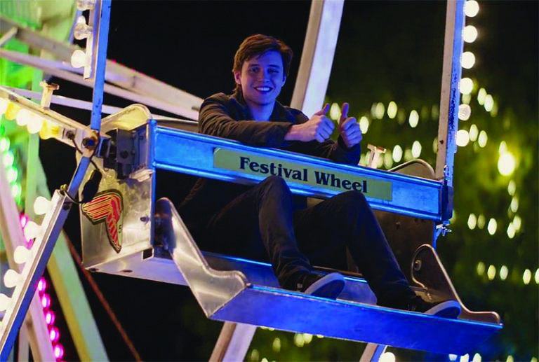 Photo, of Simon at the fair waiting for Blue to arrive, courtesy of IMDb.com