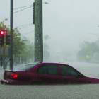 A car is submerging on the streets of Hawaii after floods  from hurricane Lane. Photo courtesy of nymag.com