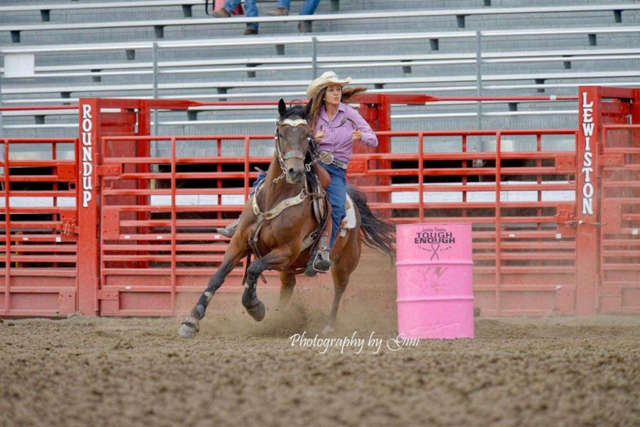 Annella+Tucker+races+around+the+pink+barrels+at+Lewiston+Roundup+tryouts.+