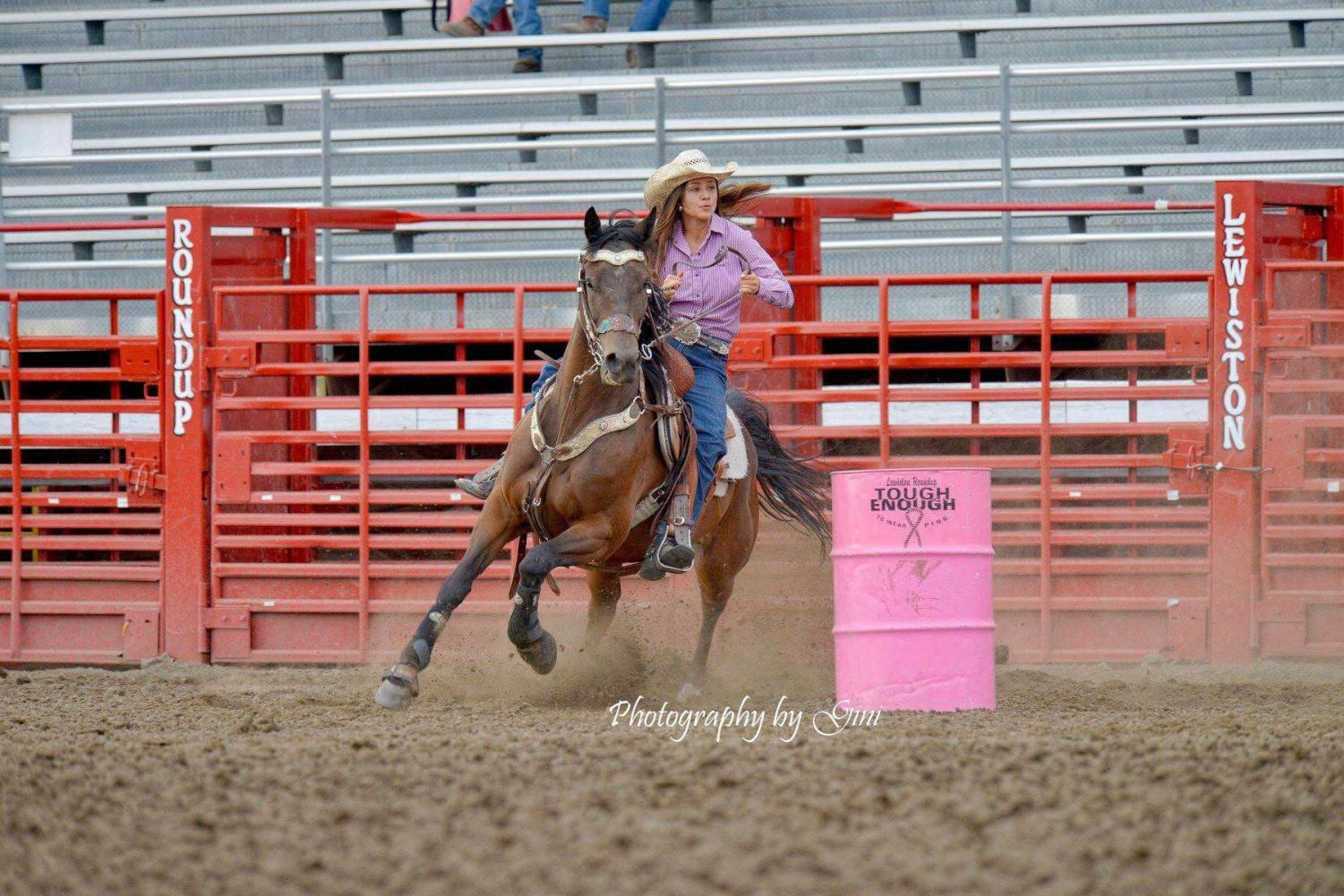 Annella Tucker races around the pink barrels at Lewiston Roundup tryouts.