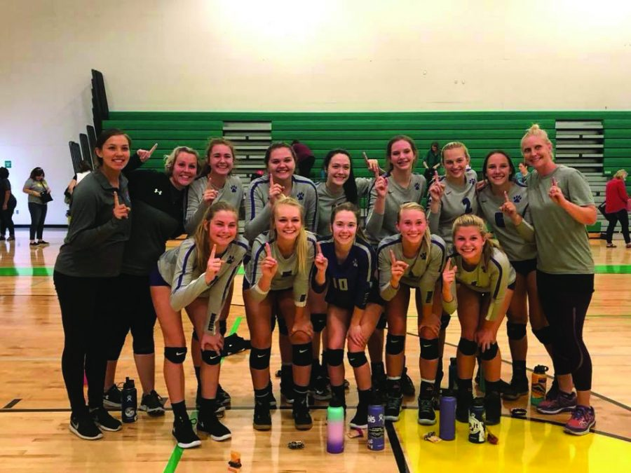 Varsity+volleyball+players+smile+after+the+Lakeland+Tournament+Sept.+8.+