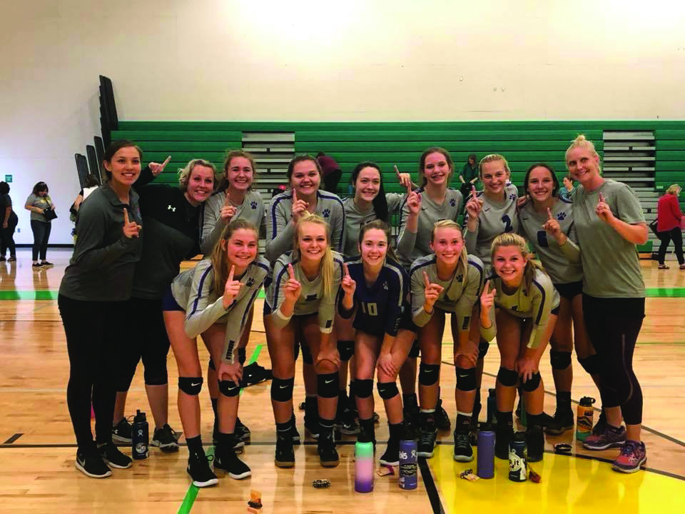 Varsity volleyball players smile after the Lakeland Tournament Sept. 8.