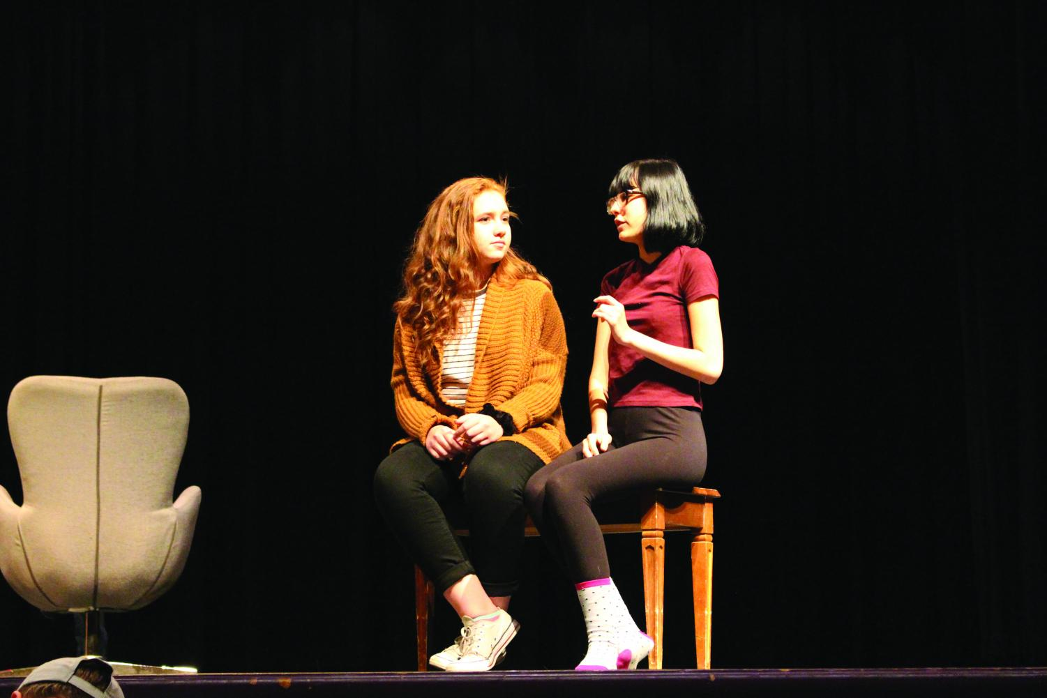 Camrynn Kernann and Trinity Nomee rehearse their scene together for LHS Drama Club's upcoming show, The Importance of Being Earnest. Photo by Josie Hafer.