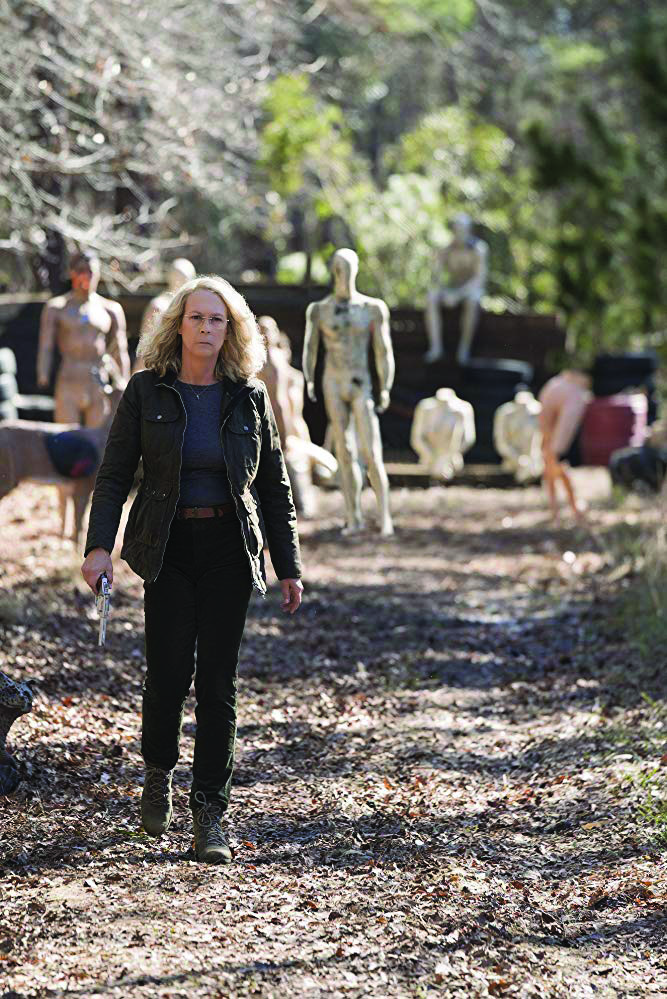 Laurie Strode walks through her yard filled with mannequins she uses as target practice. Photo courtesy of IMDb.com