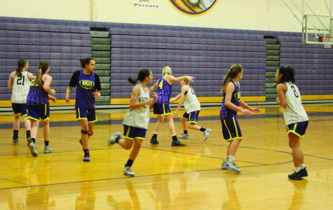 Varsity basketball starts out rough; gains traction