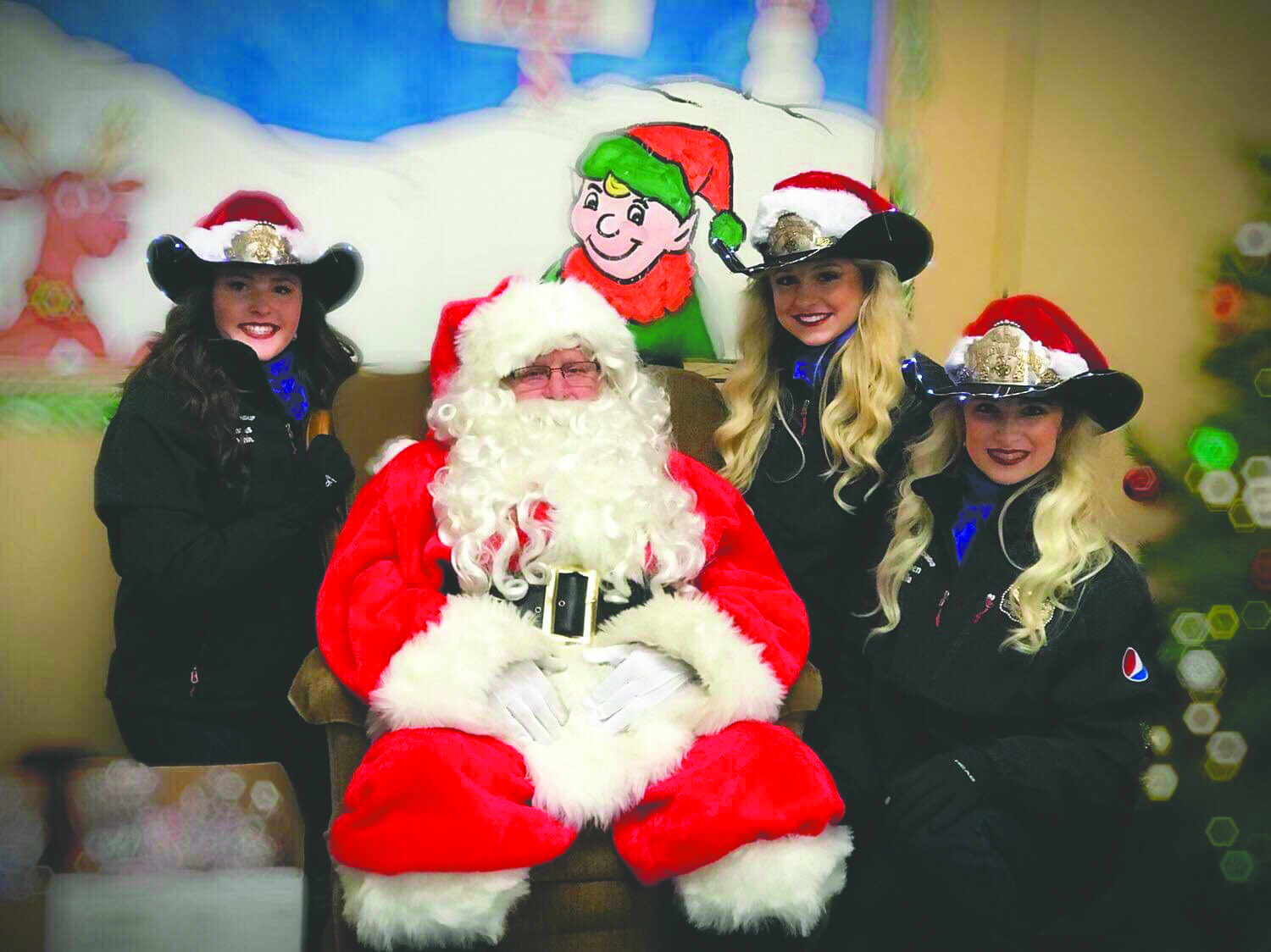 Lewiston's Roundup Royalty paid a visit to Santa on Dec. 9. Photo courtesy of Amie Greenfield.