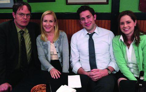 Dwight, Angela, Jim, and Pam sit together. Photo courtesy of IMDb.