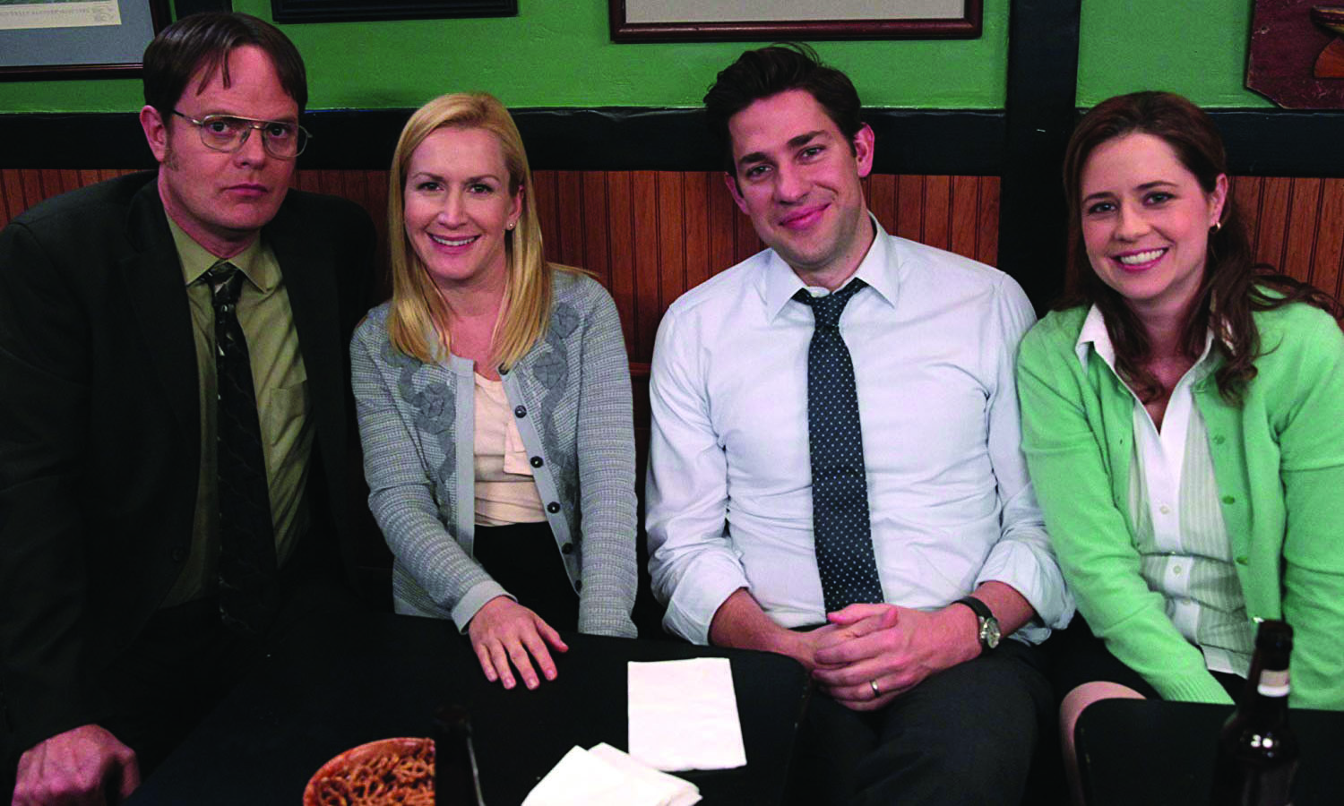 Dwight, Angela, Jim, and Pam sit together. Photo courtesy of IMDb.