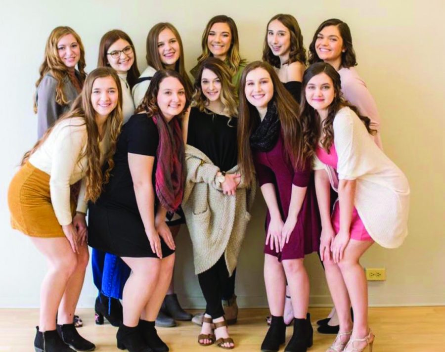 The 2019 Distinguished Young Woman team show smiles at a photoshoot in late March.