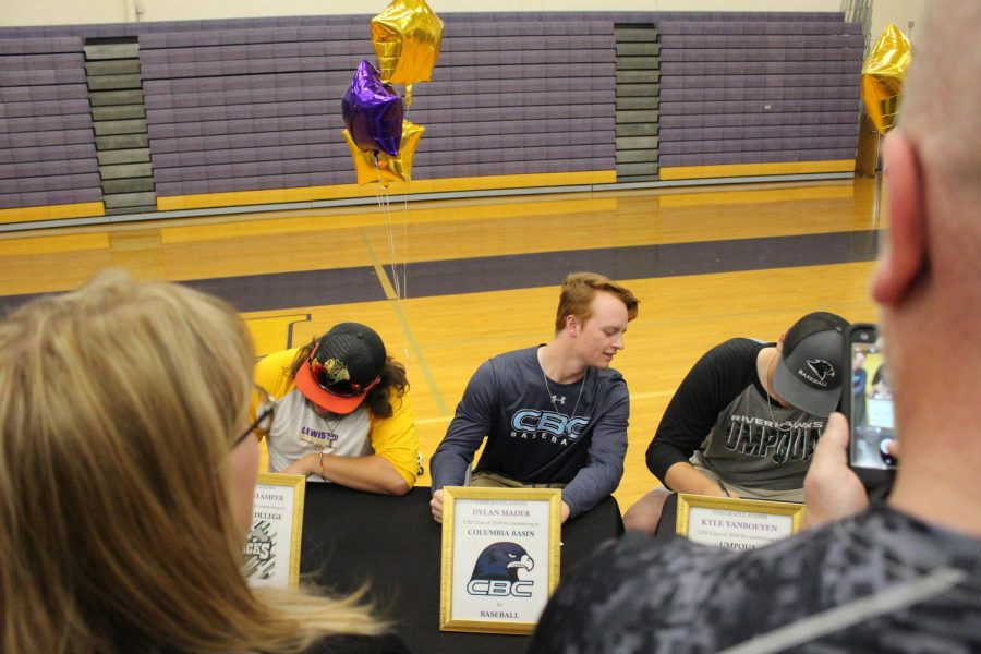 Nearly 20 senior Bengal athletes signed to colleges May 23 at Booth Hall.