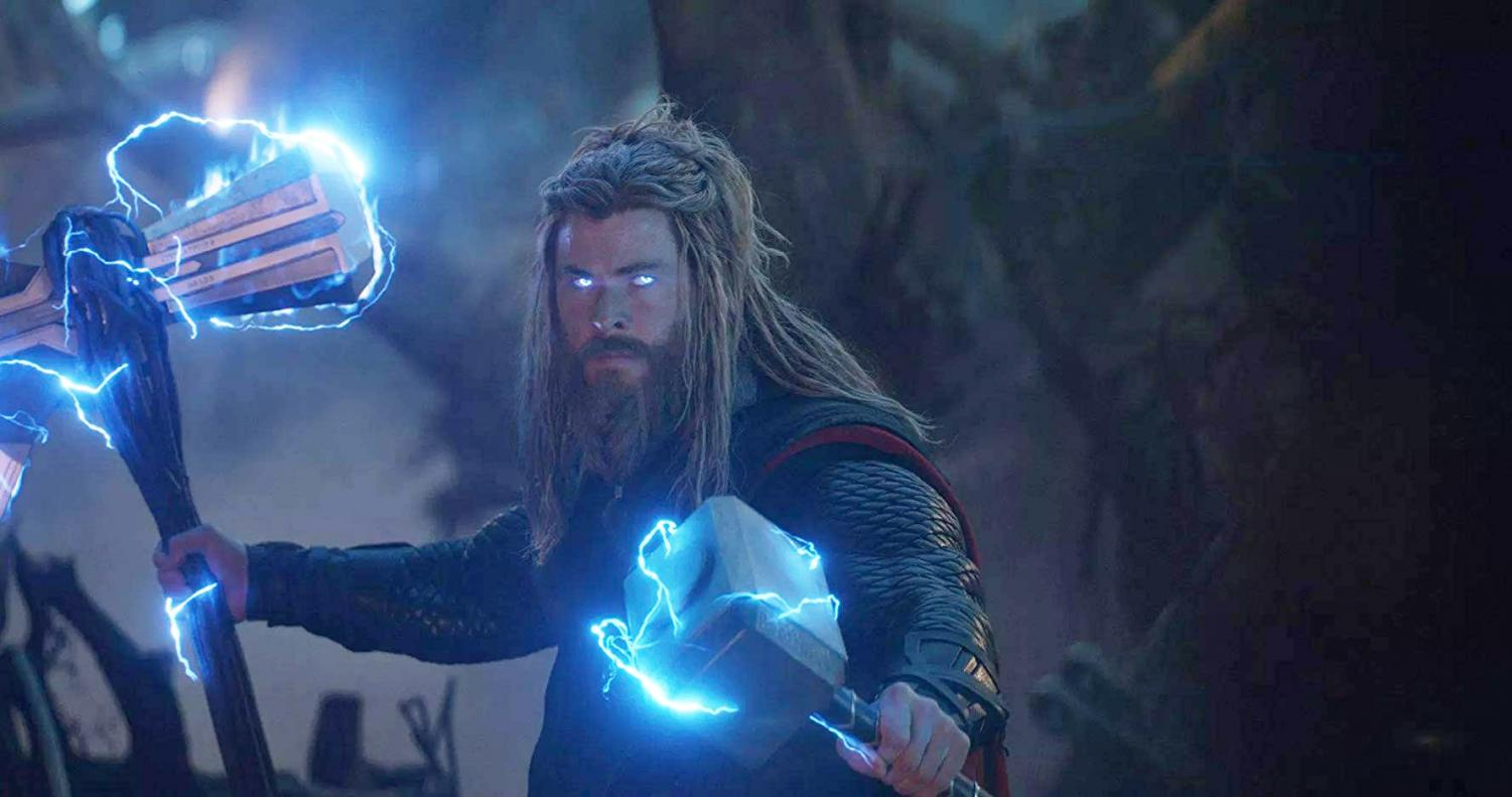 Thor (Chris Hemsworth) debuts his new look while wielding both Stormbreaker and Mjolnir.