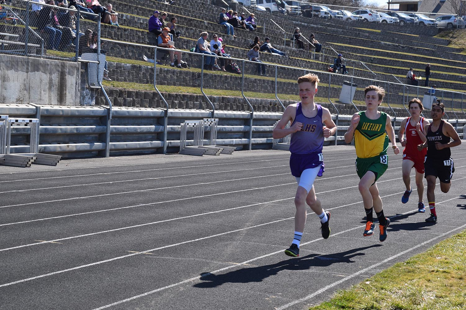 Dawson Key (left) runs for LHS track.