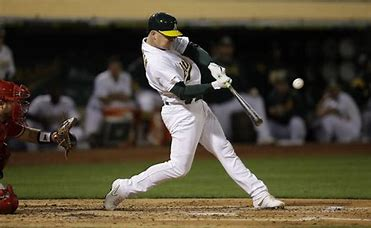 Seth Brown bats his second triple against the Los Angeles Angels at the Oakland Coliseum Sept. 3. Photo courtesy of the San Fransisco Examiner.
