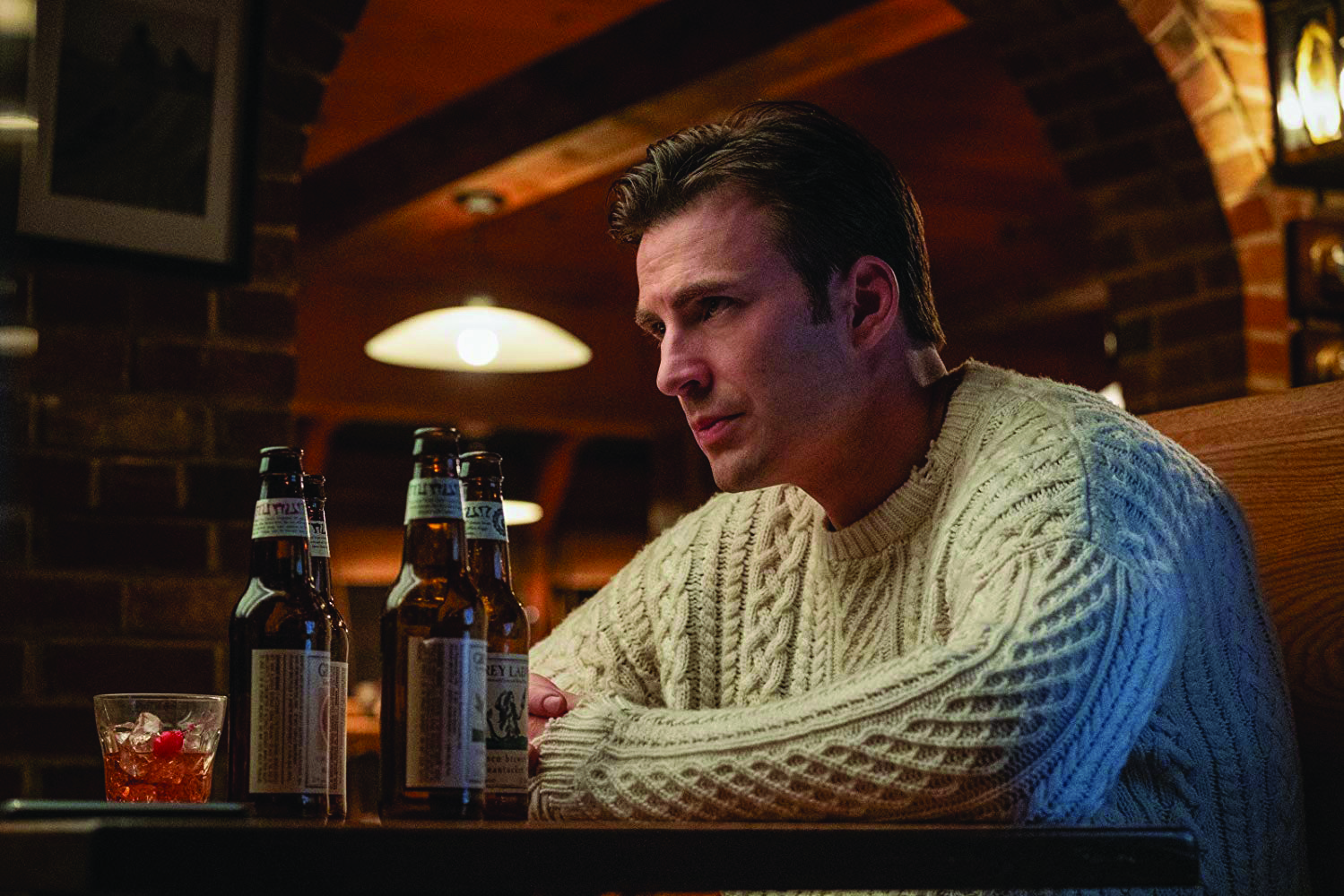 Chris Evans stares sullenly while playing Ransom Thrombey. Photo courtesy of IMDb.