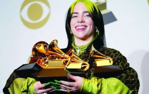Billie Elish displays her collection of grammy trophies. Photo courtesy of Billboard.com.