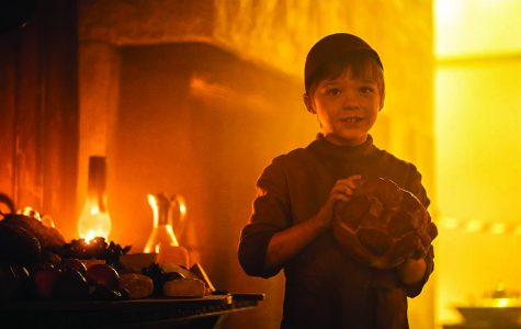Hansel hold a loaf of bread. Photo courtesy of IMDb