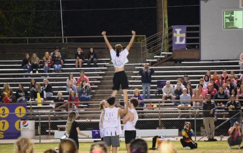 LHS boys demonstrate excellent cheer-leading skills at 2019 Powderpuff football game. Photo courtesy of Mindy Pals