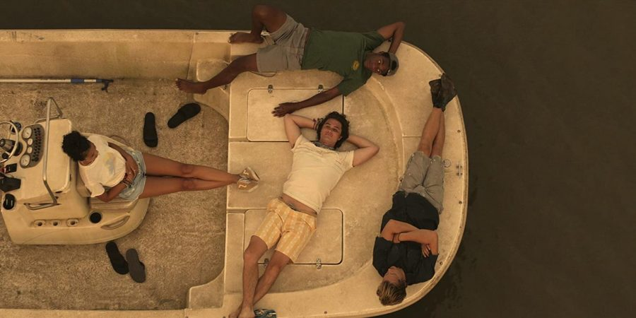 Actors from new Netflix show, Outer Banks, lay on a boat during filming in the summer. Photo courtesy of IMDb.