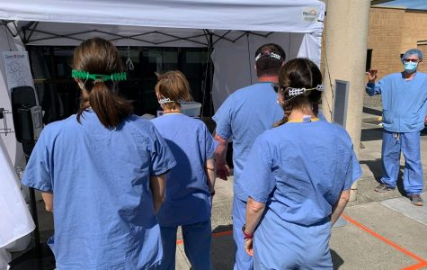 Nurses trying out the ear protectors at Tri-State.
