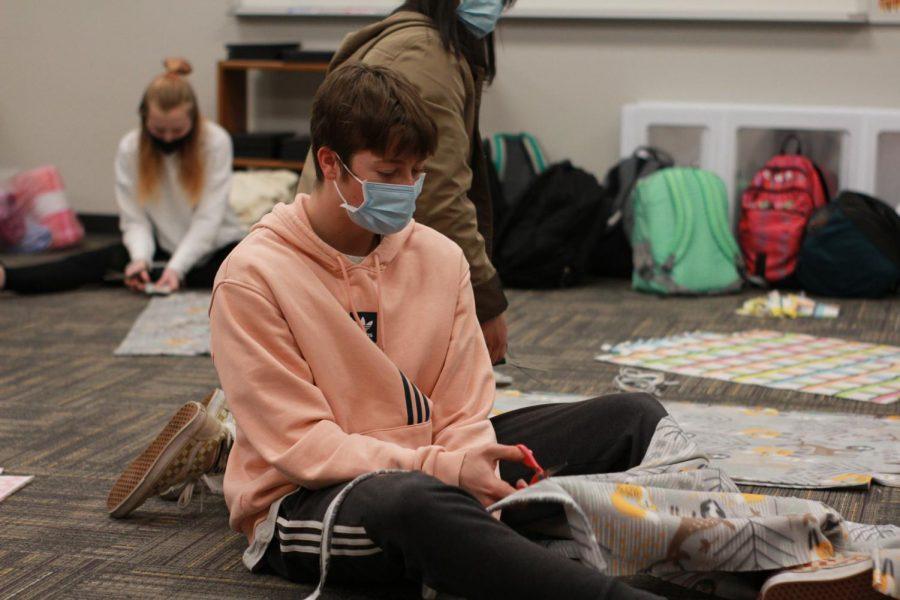 NHS members work diligently in Mrs. Bakker's room to complete blankets.