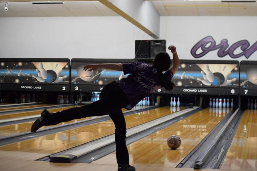 Junior+Brianna+Blamires+rolls+a+ball+down+Lane+6+for+a+strike+at+the+Top+Dog+Tournament+Feb.+13+at+Orchards+Lanes+here+in+Lewiston.+Photo+courtesy+of+Mindy+Pals.%0A