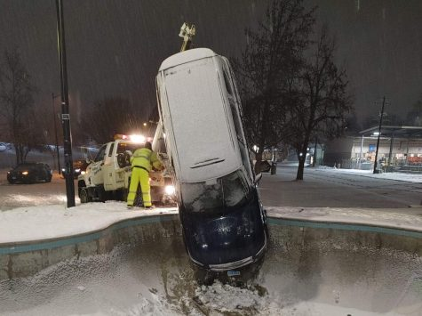 A crew removes a car from the bowl located at the Mountain Dew Skate Park Feb. 14 in Lewiston.