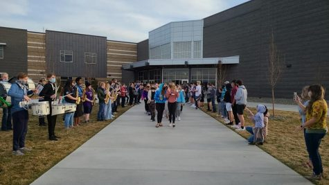 The LHS band and a group of students attend the send-off for the cheer team, as they leave for state. Photo courtesy of Mindy Pals