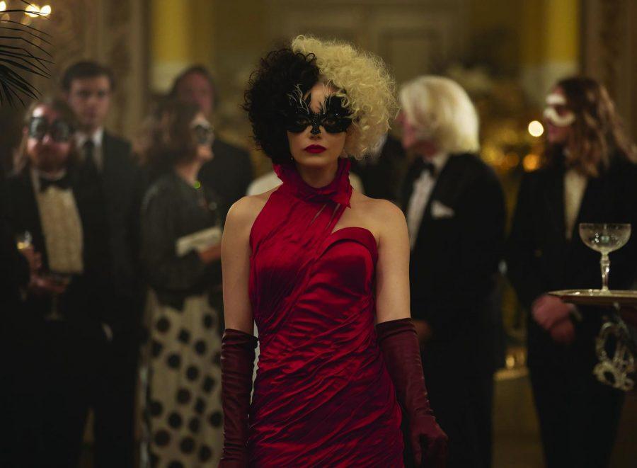 Cruella, played by Emma Stone, strutting confidently through a lavish party. Image courtesy of Disneyplus.com